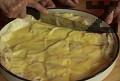 Нарязваме вече наложената баница на ромбчета. Печем в загрята фурна на 180 градуса за 30-40 мин.