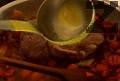 Поливаме ястието с вино и телешки бульон, подправяме с черен пипер. Оставяме ястието да се задушава под капак на слаб огън за около 3-4 часа.