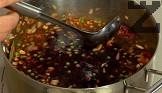 Поливаме с червеното вино, добавяме и месото. Оставяме ястието да къкри на слаб огън за 1-1,5 часа.