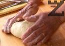 Сипваме малко топла вода и замесваме меко тесто.