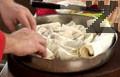 Така се оформят и останалите листа точени кори и редят в тавата. Намазваме баницата с яйце и масло и печем до златисто около 40 - 45 минути във фурна, загрята на 180 градуса. Покриваме изпечената баница с кърпа за 10-15 минути за да изпръхне, след това се поднася.