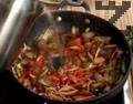 Наливаме топла вода, прибавяме нарязан чесън, лют червен пипер и чубрица. Печем ястието във фурна 20 - 30 минути.